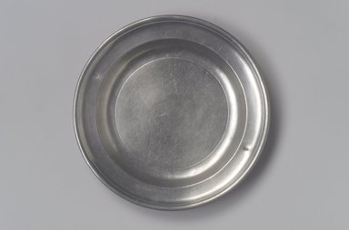 Thomas Danforth Boardman (American, 1784-1873). <em>Plate</em>, 1805-1820. Pewter, 3/4 x 6 1/8 x 6 1/8 in. (1.9 x 15.6 x 15.6 cm). Brooklyn Museum, Designated Purchase Fund, 45.10.80. Creative Commons-BY (Photo: Brooklyn Museum, 45.10.80.jpg)