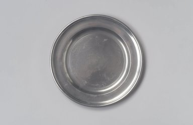 Joseph Danforth. <em>Plate (Used as Paten)</em>, 1780-1788. Pewter, 5/8 x 8 x 8 in. (1.6 x 20.3 x 20.3 cm). Brooklyn Museum, Designated Purchase Fund, 45.10.81. Creative Commons-BY (Photo: Brooklyn Museum, 45.10.81.jpg)