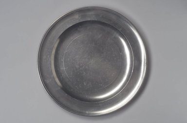 Thomas Danforth Boardman (American, 1784-1873). <em>Dish</em>, 1805-1820. Pewter, 3/4 x 12 1/4 x 12 1/4 in. (1.9 x 31.1 x 31.1 cm). Brooklyn Museum, Designated Purchase Fund, 45.10.86. Creative Commons-BY (Photo: Brooklyn Museum, 45.10.86.jpg)