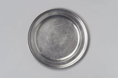 Nathaniel Austin. <em>Plate</em>, 1763-1807. Pewter, 1/2 x 8 3/4 x 8 3/4 in. (1.3 x 22.2 x 22.2 cm). Brooklyn Museum, Designated Purchase Fund, 45.10.9. Creative Commons-BY (Photo: Brooklyn Museum, 45.10.9.jpg)