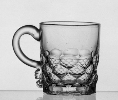 American. <em>Mug</em>, ca. 1869. Glass, H: 2 7/8 in. (7.3 cm). Brooklyn Museum, Dick S. Ramsay Fund, 45.143.40. Creative Commons-BY (Photo: Brooklyn Museum, 45.143.40_acetate_bw.jpg)