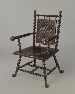 American. <em>Armchair</em>, ca. 1885. Mahogany, brass, 39 3/8 × 24 × 18 1/2 in. (100 × 61 × 47 cm). Brooklyn Museum, Gift of Eleanor Curnow in memory of her mother, Mary Griffith Curnow, 45.25.13. Creative Commons-BY (Photo: Brooklyn Museum, 45.25.13_PS6.jpg)