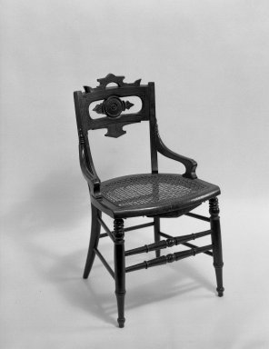T. Brooks & Company. <em>Side Chair</em>. Walnut wood, Overall height: 33 3/4 in. (85.7 cm). Brooklyn Museum, Gift of Eleanor Curnow in memory of her mother, Mary Griffith Curnow, 45.25.8. Creative Commons-BY (Photo: Brooklyn Museum, 45.25.8_acetate_bw.jpg)
