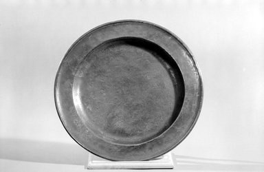 William Will. <em>Platter</em>, 1764-1798. Pewter, 1 1/8 x 16 5/8 x 16 5/8 in. (2.9 x 42.2 x 42.2 cm). Brooklyn Museum, Dick S. Ramsay Fund, 45.48. Creative Commons-BY (Photo: Brooklyn Museum, 45.48_bw.jpg)