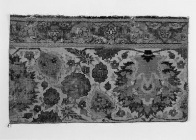 <em>Border Fragment of a Carpet with Pattern of Scrolling Vines and Animals</em>, early 17th century. Wool and cotton, 31 x 18 1/2 in. (78.7 x 47 cm). Brooklyn Museum, Brooklyn Museum Collection, X1103.3. Creative Commons-BY (Photo: Brooklyn Museum, 45.66.4_bw.jpg)