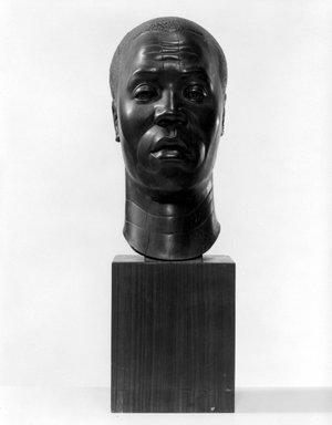 Harry Levine (American, born Russia, 1893-1945). <em>Negro Head</em>, n.d. Lignum vitae (wood), With Base: 18 × 5 5/8 × 7 3/4 in., 15 lb. (45.7 × 14.3 × 19.7 cm, 6.8kg). Brooklyn Museum, Gift of the Educational Alliance Art School, 45.67.1. © artist or artist's estate (Photo: Brooklyn Museum, 45.67.1_bw.jpg)