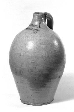 Peter Cross (American). <em>Jug</em>, ca. 1805-1810. Stoneware, 12 1/8 x 4 3/4 in. (30.8 x 12.1 cm). Brooklyn Museum, Gift of Arthur W. Clement, 46.1.1. Creative Commons-BY (Photo: Brooklyn Museum, 46.1.1_bw.jpg)