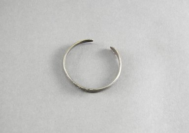 <em>Bracelet</em>. Lead (probably) Brooklyn Museum, Gift of Annette Dotter, 46.111.5. Creative Commons-BY (Photo: Brooklyn Museum, 46.111.5_PS5.jpg)
