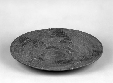 Yokuts. <em>Basketry Tray</em>. Fiber, 2 3/4 × 18 7/16 × 18 7/16 in. (7 × 46.8 × 46.8 cm). Brooklyn Museum, Gift of Pratt Institute, 46.136.10. Creative Commons-BY (Photo: Brooklyn Museum, 46.136.10_bw.jpg)