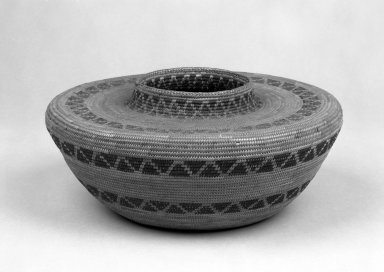 Yokuts. <em>Coiled Basket with Flat Shoulders and Short Straight Neck decorated with bands of triangles</em>. Fiber, 5 5/16 × 10 11/16 × 10 11/16 in. (13.5 × 27.1 × 27.1 cm). Brooklyn Museum, Gift of Pratt Institute, 46.136.4. Creative Commons-BY (Photo: Brooklyn Museum, 46.136.4_bw.jpg)