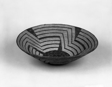 Possibly Pima. <em>Broad Basketry Bowl</em>. Fiber, 4 5/8 × 17 1/4 × 17 1/4 in. (11.7 × 43.8 × 43.8 cm). Brooklyn Museum, Gift of Pratt Institute, 46.136.8. Creative Commons-BY (Photo: Brooklyn Museum, 46.136.8_bw.jpg)