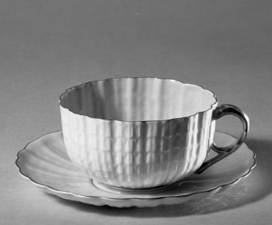 "American. <em>Cup and Saucer</em>, 1879-1900. Porcelain, Height of cup 1 13/16 Diameter of saucer 5 3/8"": 1 13/16 × 5 3/8 in. (4.6 × 13.7 cm). Brooklyn Museum, Gift of Julie Husson, 46.144.3a-b. Creative Commons-BY (Photo: Brooklyn Museum, 46.144.3a-b_acetate_bw.jpg)"