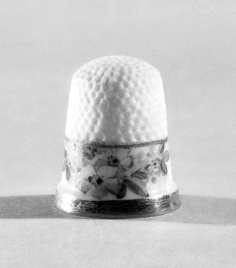 American. <em>Thimble</em>, ca. 1883-1892. Porcelain, 3/4 x 5/8 in. (1.9 x 1.6 cm). Brooklyn Museum, Gift of Julie Husson, 46.144.5. Creative Commons-BY (Photo: Brooklyn Museum, 46.144.5_bw.jpg)