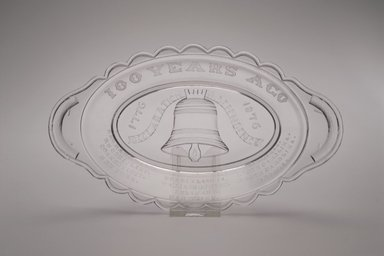 American. <em>Pickle Dish (Centennial)</em>, ca. 1876. Glass, 1 3/8 x 9 3/8 x 5 3/8 in. (3.5 x 23.8 x 13.7 cm). Brooklyn Museum, Anonymous gift, 46.161.2. Creative Commons-BY (Photo: Brooklyn Museum, 46.161.2_Justin_van_Soest_photograph.jpg)