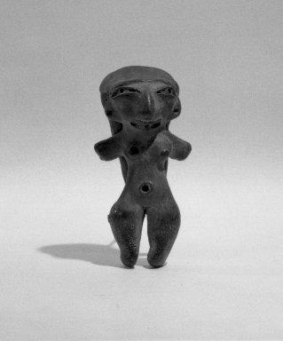 <em>Small Female Figurine</em>. Ceramic, 7/8 x 1 x 2 1/4 in. (2.2 x 2.5 x 5.7 cm). Brooklyn Museum, Henry L. Batterman Fund, 46.180.3. Creative Commons-BY (Photo: Brooklyn Museum, 46.180.3_acetate_bw.jpg)
