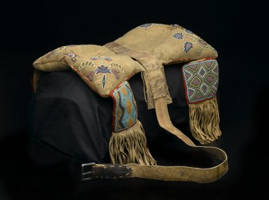 Cree-Metis. <em>Beaded Saddle</em>, pre 1850. Hide, beads, pigment stroud wool cloth, deer or buffalo hair, old hide parfleche, metal, canvas, 19 1/8 x 13 3/8in. (48.5 x 34cm). Brooklyn Museum, Henry L. Batterman Fund, 46.78.7. Creative Commons-BY (Photo: Brooklyn Museum, 46.78.7_PS2.jpg)