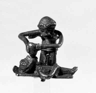 Akan. <em>Gold-weight (abrammuo): figures</em>. Brass, 1 3/16 x 1 3/16 x 13/16 in. (3 x 3 x 2 cm). Brooklyn Museum, Charles Stewart Smith Memorial Fund, 46.95.2. Creative Commons-BY (Photo: Brooklyn Museum, 46.95.2_bw.jpg)