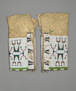 Lakota, Sioux. <em>Woman's Leggings</em>, ca. 1870-1895. Hide, metal, beads, 15 x 8 in.  (38.1 x 20.3 cm). Brooklyn Museum, Charles Stewart Smith Memorial Fund, 46.96.10a-b. Creative Commons-BY (Photo: Brooklyn Museum, 46.96.10a-b_PS2.jpg)