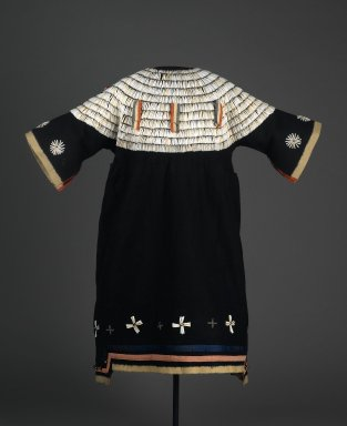 Possibly Sioux. <em>Dress</em>, 1875-1900. Wool cloth, dentalium shells, ribbon, glass beads, brass bells, cotton, 43 5/16 x 33 7/16in. (110 x 85cm). Brooklyn Museum, Charles Stewart Smith Memorial Fund, 46.96.12. Creative Commons-BY (Photo: Brooklyn Museum, 46.96.12_front_PS2.jpg)