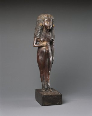 <em>Lady Mi</em>, ca. 1390-1353 B.C.E. Wood, bone?, gold leaf, 6 1/8 x 1 3/4 x 2 1/4 in. (15.6 x 4.4 x 5.7 cm). Brooklyn Museum, Charles Edwin Wilbour Fund, 47.120.3. Creative Commons-BY (Photo: Brooklyn Museum, 47.120.3_threequarter_SL1.jpg)