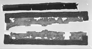 "Paracas Necropolis ""linear"". <em>Mantle, Border, Fragment</em>, 100 B.C.E.-600 C.E. Cotton, camelid fiber, 94 1/8 x 9 1/16 in.  (239.0 x 23.0 cm). Brooklyn Museum, Gift of John Wise, 47.13.2. Creative Commons-BY (Photo: , 47.13.2_34.1541a-b_group_bw.jpg)"