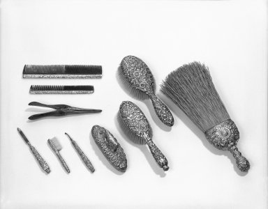 Tiffany & Company (American, founded 1853). <em>Large Hair Brush</em>, ca. 1880. Sterling silver, length: 8 3/4 in. Brooklyn Museum, Anonymous gift, 47.165.1. Creative Commons-BY (Photo: Brooklyn Museum, 47.165.1_group_bw.jpg)