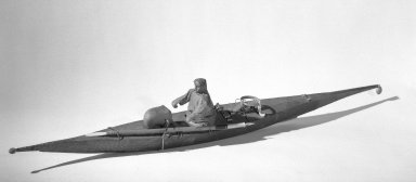 <em>Model of a Kayak</em>. Wood, sealskin (?), 29 1/2 x 2 15/16in. (75 x 7.5cm). Brooklyn Museum, Gift of Sidney Weiner and Harry Hurdy, 47.172.1. Creative Commons-BY (Photo: Brooklyn Museum, 47.172.1_acetate_bw.jpg)