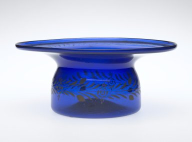 <em>Bowl</em>, 19th century. Translucent deep blue glass; free blown and gilded; tooled on the pontil, 3 3/4 x 8 7/8 in. (9.5 x 22.5 cm). Brooklyn Museum, Henry L. Batterman Fund, 47.203.18. Creative Commons-BY (Photo: Brooklyn Museum, 47.203.18_PS2.jpg)