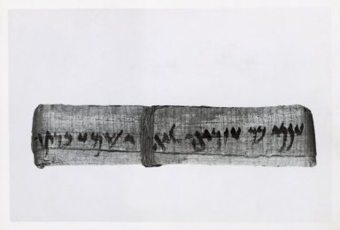 Aramaic. <em>Ananiah Gives Yehoishema a House</em>, March 10, 402 B.C.E. Papyrus, ink, mud, linen, Glass: 15 3/8 x 19 1/2 in. (39.1 x 49.5 cm). Brooklyn Museum, Bequest of Theodora Wilbour from the collection of her father, Charles Edwin Wilbour, 47.218.88 (Photo: Brooklyn Museum, 47.218.88_NegD_SL1.jpg)