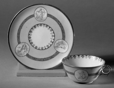 Mercer Pottery Company. <em>Cup and Saucer</em>. Brooklyn Museum, Gift of Mrs. Willard C. Brinton, 47.30.15. Creative Commons-BY (Photo: Brooklyn Museum, 47.30.15_acetate_bw.jpg)