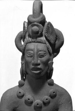 <em>Maya Figurine</em>. Clay, 10 1/4 × 2 1/2 × 1 3/4 in. (26 × 6.4 × 4.4 cm). Brooklyn Museum, 48.2.12. Creative Commons-BY (Photo: Brooklyn Museum, 48.2.12_detail2_acetate_bw.jpg)