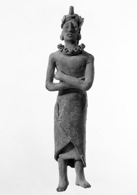 <em>Maya Figurine</em>. Clay, 10 1/4 × 2 3/4 × 1 7/8 in. (26 × 7 × 4.8 cm). Brooklyn Museum, 48.2.2. Creative Commons-BY (Photo: Brooklyn Museum, 48.2.2_bw.jpg)