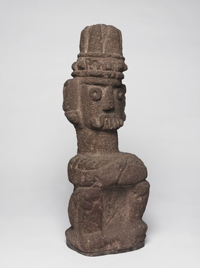 Aztec. <em>Seated Figure of Tlaloc</em>, ca. 1440-1521. Stone, 20 1/2 x 6 11/16 x 5 1/8 in. (52 x 17 x 13 cm). Brooklyn Museum, By exchange, 48.22.8. Creative Commons-BY (Photo: Brooklyn Museum, 48.22.8_threequarter_right_PS9.jpg)