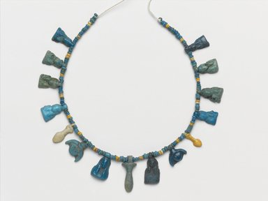 <em>Single-Strand Necklace</em>, ca. 1332-1292 B.C.E. Faience, 11/16 x 1/8 x 7 1/2 in. (1.7 x 0.3 x 19.1 cm). Brooklyn Museum, Gift of Mrs. Lawrence Coolidge and Mrs. Robert Woods Bliss, and the Charles Edwin Wilbour Fund, 48.66.40. Creative Commons-BY (Photo: Brooklyn Museum, 48.66.40_PS2.jpg)