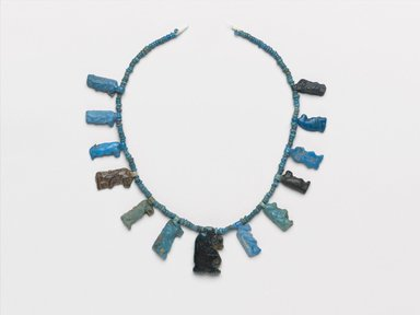<em>Single-Strand Necklace with Taweret Amulets</em>, ca. 1332-1292 B.C.E. Faience, 3/4 x 8 1/16 x 3/16 in. (1.9 x 20.5 x 0.4 cm). Brooklyn Museum, Gift of Mrs. Lawrence Coolidge and Mrs. Robert Woods Bliss, and the Charles Edwin Wilbour Fund, 48.66.42. Creative Commons-BY (Photo: Brooklyn Museum, 48.66.42_PS2.jpg)
