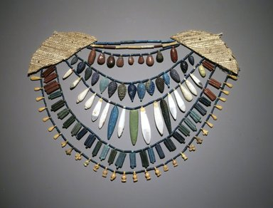 <em>Five Rowed Necklace with Amulets</em>, ca. 1390-1352 B.C.E. Faience, 6 3/4 x 13 3/4 in. (17.1 x 35 cm). Brooklyn Museum, Gift of Mrs. Lawrence Coolidge and Mrs. Robert Woods Bliss, and the Charles Edwin Wilbour Fund, 48.66.69. Creative Commons-BY (Photo: Brooklyn Museum, 48.66.69_transpc002.jpg)