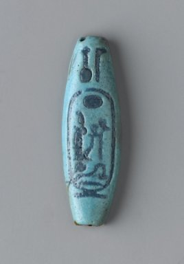 <em>Bead with Cartouche of Ramesses II</em>, ca. 1292–1190 B.C. Faience, 9/16 x 3/16 x 1 15/16 in. (1.5 x 0.5 x 4.9 cm). Brooklyn Museum, Charles Edwin Wilbour Fund, 49.11. Creative Commons-BY (Photo: Brooklyn Museum, 49.11_front_PS2.jpg)