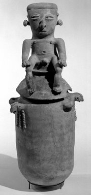 Moskito style. <em>Burial Urn with Male Effigy Figure</em>, 1000-1500 C.E. Ceramic, pigment, slip, A: 15 3/8 x 7 3/8 in. (39 x 18.7 cm). Brooklyn Museum, Frank L. Babbott Fund, 49.191.2a. Creative Commons-BY (Photo: Brooklyn Museum, 49.191.2a-b_acetate_bw.jpg)