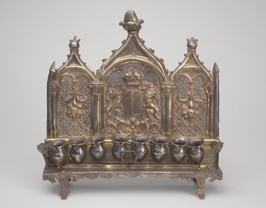 <em>Hanukkah Menorah</em>, late 19th century. Silver, 10 1/2 x 10 5/8 x 2 7/8 in. (26.7 x 27 x 7.3 cm). Brooklyn Museum, Purchased with funds given by Mr. and Mrs. Benjamin Abrams, 49.228.11. Creative Commons-BY (Photo: Brooklyn Museum, 49.228.11.jpg)