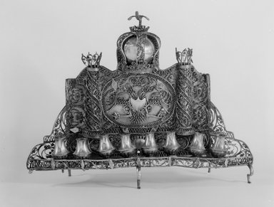 <em>Hanukkah Menorah</em>, ca. 1830-1850. Silver, 9 1/2 x 12 1/8 x 3 1/2 in. (24.1 x 30.8 x 8.9 cm). Brooklyn Museum, Purchased with funds given by Fred Zeitz, 49.228.14. Creative Commons-BY (Photo: Brooklyn Museum, 49.228.14_bw.jpg)