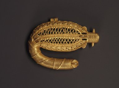 Ebrié. <em>Pendant in the Form of a Sawfish</em>, 19th century. Gold, 2 3/16 x 3/8 x 2 15/16 in. (5.5 x 1 x 7.5 cm). Brooklyn Museum, A . Augustus Healy Fund, 49.32.2. Creative Commons-BY (Photo: Brooklyn Museum, 49.32.2_SL1.jpg)