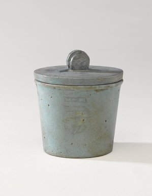 <em>One of a Set of Jars for Seven Sacred Oils or Unguents</em>, 305-30 B.C.E. Faience, 2 1/2 x 2 3/8 in. (6.4 x 6 cm). Brooklyn Museum, Charles Edwin Wilbour Fund, 49.52.2a-b. Creative Commons-BY (Photo: Brooklyn Museum, 49.52.2a-b_PS9.jpg)
