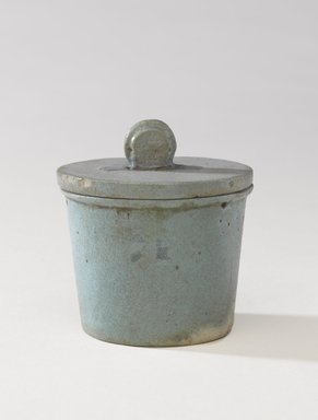 <em>One of a Set of Jars for Seven Sacred Oils or Unguents</em>, 305-30 B.C.E. Faience, 2 1/2 x 2 3/8 in. (6.4 x 6 cm). Brooklyn Museum, Charles Edwin Wilbour Fund, 49.52.3a-b. Creative Commons-BY (Photo: Brooklyn Museum, 49.52.3a-b_PS9.jpg)
