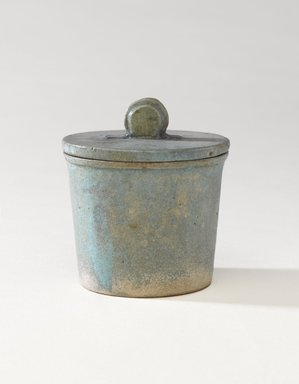 <em>One of a Set of Jars for Seven Sacred Oils or Unguents</em>, 305-30 B.C.E. Faience, 2 1/2 x 2 3/8 in. (6.4 x 6 cm). Brooklyn Museum, Charles Edwin Wilbour Fund, 49.52.4a-b. Creative Commons-BY (Photo: Brooklyn Museum, 49.52.4a-b_PS9.jpg)
