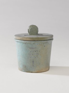 <em>One of a Set of Jars for Seven Sacred Oils or Unguents</em>, 305-30 B.C.E. Faience, 2 1/2 x 2 3/8 in. (6.4 x 6 cm). Brooklyn Museum, Charles Edwin Wilbour Fund, 49.52.5a-b. Creative Commons-BY (Photo: Brooklyn Museum, 49.52.5a-b_PS9.jpg)