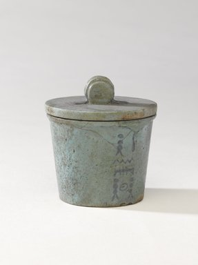 <em>One of a Set of Jars for Seven Sacred Oils or Unguents</em>, 305-30 B.C.E. Faience, 2 1/2 x 2 3/8 in. (6.4 x 6 cm). Brooklyn Museum, Charles Edwin Wilbour Fund, 49.52.7a-b. Creative Commons-BY (Photo: Brooklyn Museum, 49.52.7a-b_PS9.jpg)