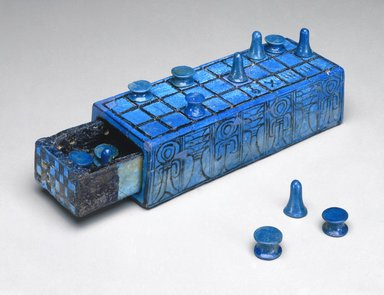 <em>Set of Thirteen Gaming Pieces</em>, ca. 1390-1353 B.C.E. Faience, Greatest dimensions for reel-shaped pieces: 1/2 x Diam. 13/16 in. (1.3 x 2 cm). Brooklyn Museum, Charles Edwin Wilbour Fund, 49.57.1-.13. Creative Commons-BY (Photo: , 49.56a-b_49.57.1-.13_SL1.jpg)