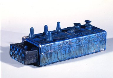 <em>Gaming Board Inscribed for Amenhotep III with Separate Sliding Drawer</em>, ca. 1390-1353 B.C.E. Faience, 2 3/16 x 3 1/16 x 8 1/4 in. (5.5 x 7.7 x 21 cm). Brooklyn Museum, Charles Edwin Wilbour Fund, 49.56a-b. Creative Commons-BY (Photo: Brooklyn Museum, 49.56a-b_view2_SL4.jpg)
