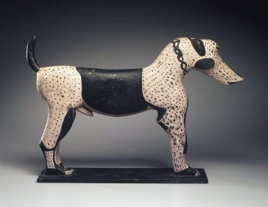 <em>Figure of Male Dog</em>, 19th century. Wood, (excluding base):10 1/2 x 16 1/4 x 2 in. (26.7 x 41.3 x 5.1 cm). Brooklyn Museum, Gift of Mr. and Mrs. Alastair B. Martin, the Guennol Collection, 50.104.2. Creative Commons-BY (Photo: Brooklyn Museum, 50.104.2.jpg)