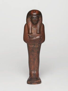 <em>Shabty of the Scribe Amunemhat</em>, ca. 1400-1336 B.C.E. Wood, pigment (Egyptian blue), 8 9/16 × 2 9/16 × 1 7/8 in. (21.8 × 6.5 × 4.8 cm). Brooklyn Museum, Charles Edwin Wilbour Fund, 50.129. Creative Commons-BY (Photo: , 50.129_PS9.jpg)